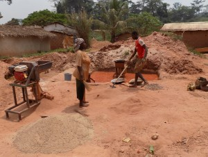 People sweeping the floor for gold ore